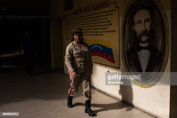 A member of the Bolivarian Militia walks inside a polling station during a nationwide mayoral election in Caracas Venezuela on Sunday Dec 10 2017...