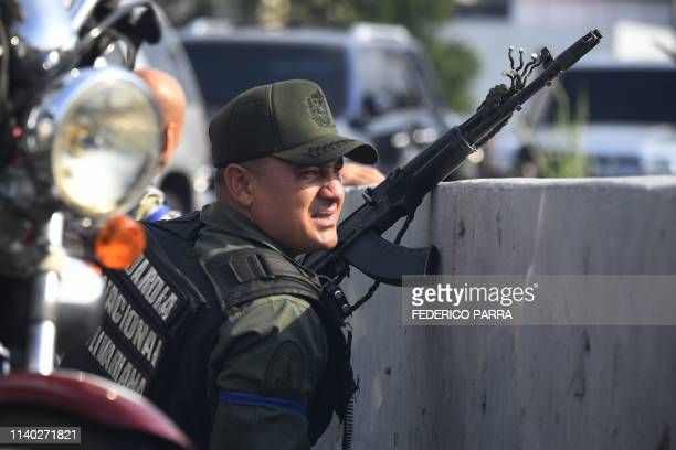 A member of the Bolivarian National Guard who joined Venezuelan opposition leader and selfproclaimed acting president Juan Guaido takes position...