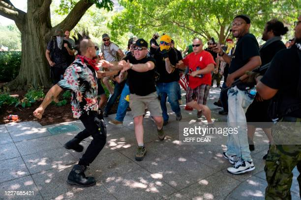 Member of the Boogaloo Movement wearing a Hawaiian shirt gets into a physical altercation with members of the Proud Boys in front of the Ohio...