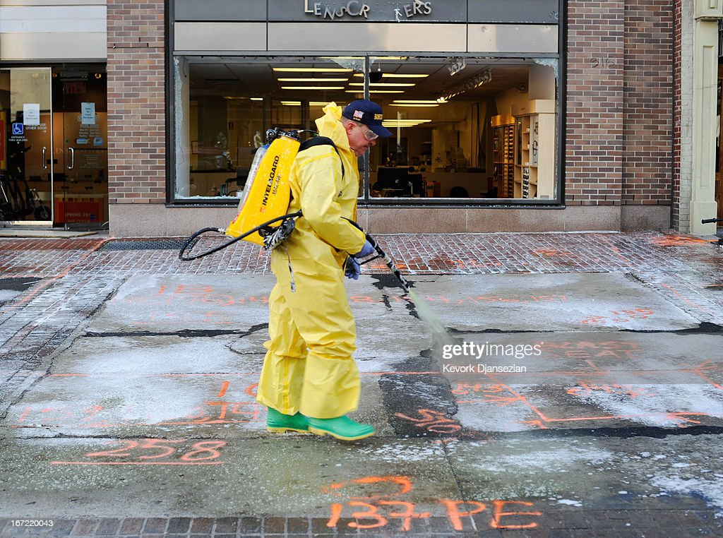A member of the Boston Fire Department Hazardous Materials team cleans the first blast site near the Boston Marathon finish line one week after the FBI handed over Boylston Street back to the city on April 22, 2013 in Boston, Massachusetts. A manhunt ended for Dzhokhar A. Tsarnaev, 19, a suspect in the Boston Marathon bombing after he was apprehended on a boat parked on a residential property in Watertown, Massachusetts. His brother Tamerlan Tsarnaev, 26, the other suspect, was shot and killed after a car chase and shootout with police. The bombing, on April 15 at the finish line of the marathon, killed three people and wounded at least 170.