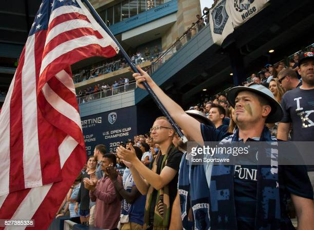 Member of the Boulevard Battery Supporters group holds a US Flag during military appreciation day before the match between Sporting Kansas City and...