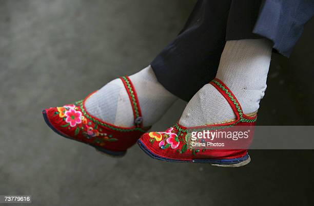 A member of the Bound Feet Women Dancing Team wearing her Three Cuns Golden Lotus shoes prepares for dancing practice at Liuyi Village on April 2...