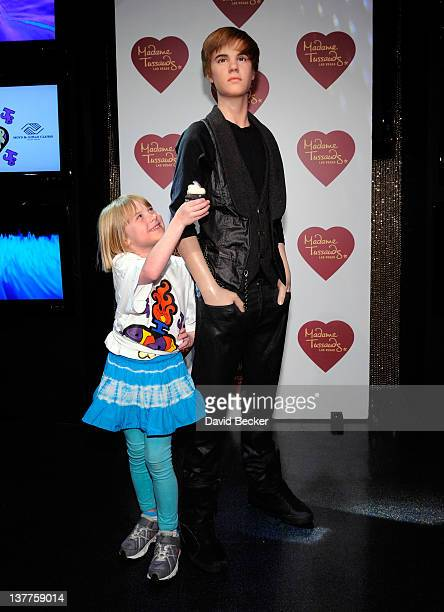 A member of the Boys and Girls Clubs of Las Vegas pose with a wax figure of singer Justin Bieber after it was unveiled at Madame Tussauds Las Vegas...