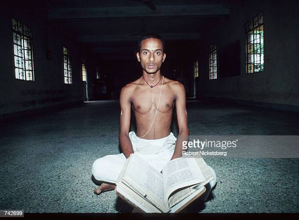 A member of the Brahmin caste sits inside a Hindu temple October 28 1991 in India Of the five castes in Hinduism Brahmins occupy the highest level...