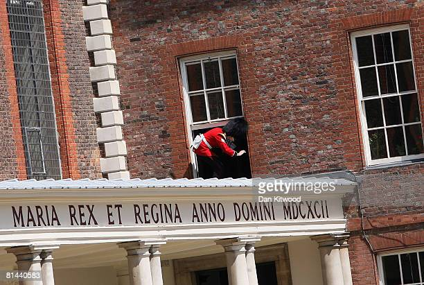 Member of the brass band climbs through an open window during the Founders Day Parade at Chelsea Royal Hospital, on June 5, 2008 in London, England....