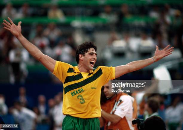 A member of the Brazil team celebrates their 3 0 gold medal win over the Netherlands in the final of the Men's volleyball event at the 1992 Summer...