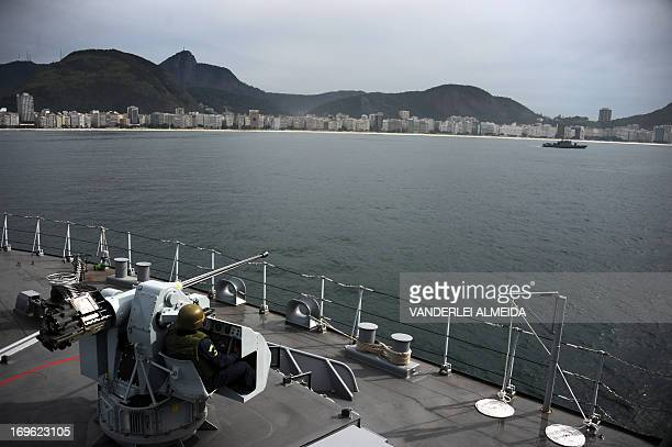 A member of the Brazilian Navy takes part in a terrorist attack drill as part of the security measures for the upcoming FIFA Confederations Cup the...