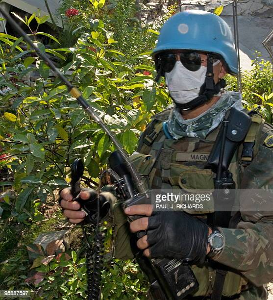 Member of the Brazilian United Nations security force based in Port-au-Prince, Haiti, walks the area around the completly destroyed Hotel Montana...