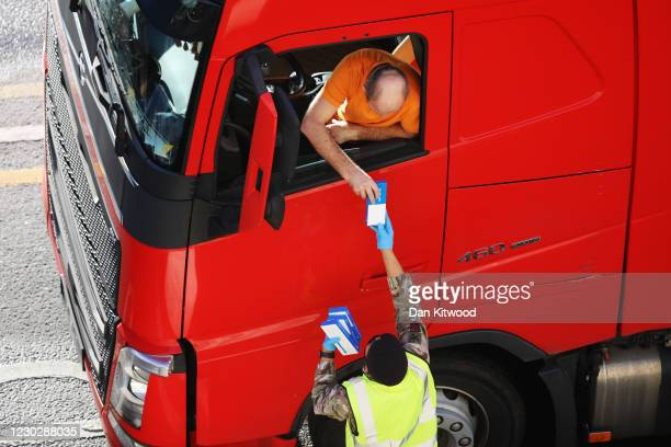 Member of the British army hands out a Covid-19 self test to a lorry driver on December 24, 2020 in Dover, United Kingdom. Travel from the UK to...