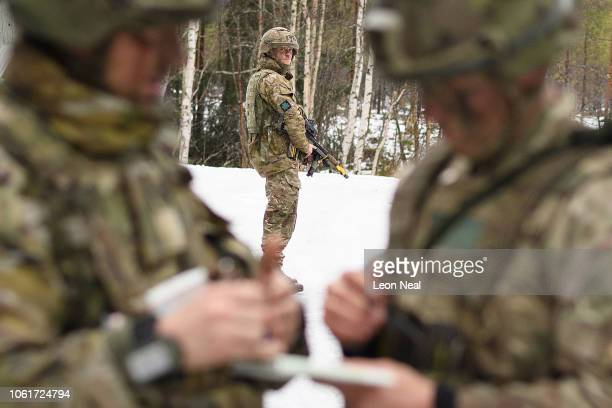 A member of the British Army looks on as a briefing takes place as they wait for an imminent attack from opposing forces on October 31 2018 in the...