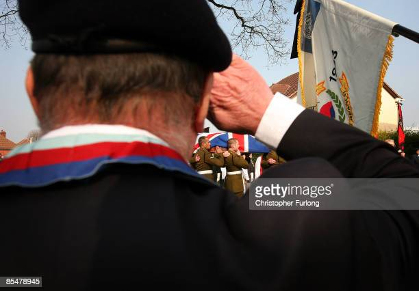 A member of the British Legion salutes as comrades carry the coffin of Sapper Mark Quinsey who was murdered in Northern Ireland into Immanuel Church...