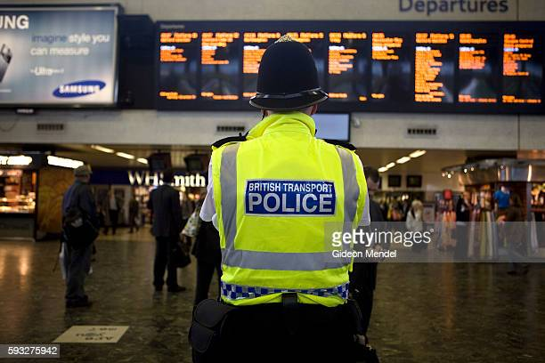 A member of the British Transport Police on guard this morning at Euston Station in London This was part of a massive security and police presence at...