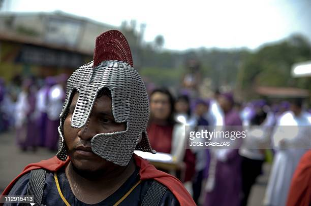 A member of the Brotherhood of El Santo Entierro participates in the Via Crucis procession as part of Good Friday ceremonies in the town of...
