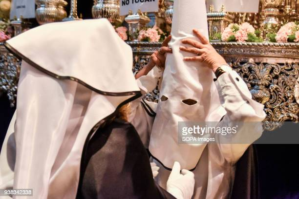 A member of the brotherhood seen wearing a mask getting ready for the procession event Holy week is one of the most important and famous religious...
