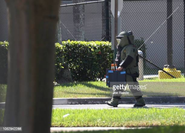 A member of the Broward Sheriff's Office bomb squad is seen as he investigates a suspicious package in the building where Rep Debbie Wasserman...
