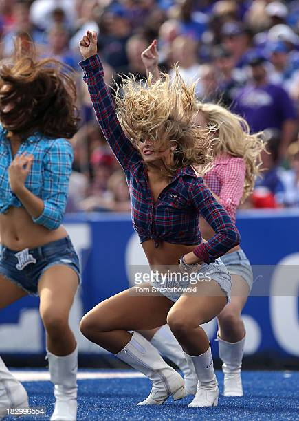 A member of the Buffalo Bills cheerleaders the Buffalo Jills performs during NFL game action against the Baltimore Ravens at Ralph Wilson Stadium on...