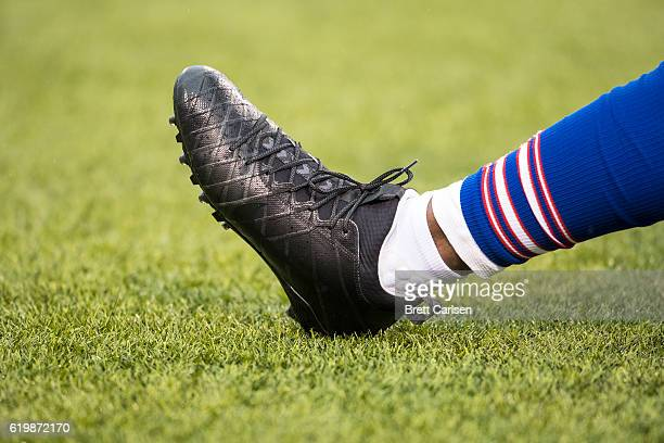 A member of the Buffalo Bills warms up while wearing Nike football cleats before the game against the New England Patriots on October 30 2016 at New...