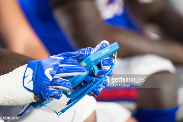 A member of the Buffalo Bills works with a Microsoft Surface tablet on the sideline during the preseason game against the Detroit Lions on August 31...