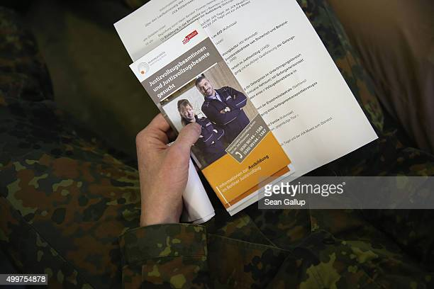 A member of the Bundeswehr the German armed forces whose twoyear commitment will end soon attends a career day hosted by the Berlin prisons system at...
