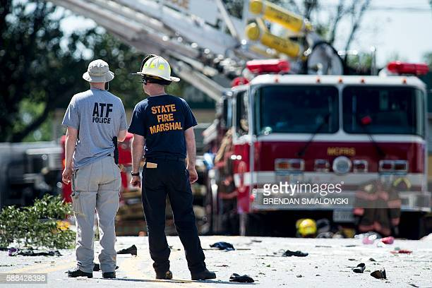 A member of the Bureau of Alcohol Tobacco Firearms and Explosives speaks with a fire marshal after an explosion at Flower Branch Apartments August 11...