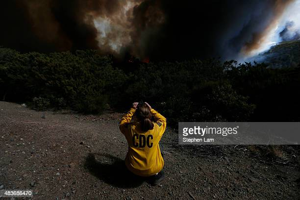 A member of the California Department of Corrections and Rehabilitation takes a photo of the Jerusalem Fire burning along Morgan Valley Road on...
