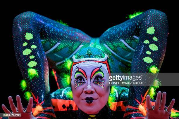 TOPSHOT A member of the Canadian circus troop 'Le Cirque du Soleil' performs during the show Totem in Paris on October 24 2018 The show Totem will...