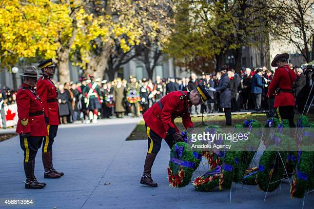 A member of the Canadian Forces place a wreath on a monument during a Remembrance Day ceremony which marks the anniversary of the official end of the...