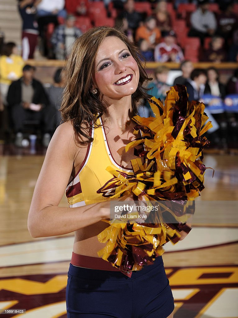 A member of the Canton Charge dance team cheers for the team during a break in the action against the Springfield Armor at the Canton Memorial Civic Center on November 24, 2012 in Canton, Ohio.