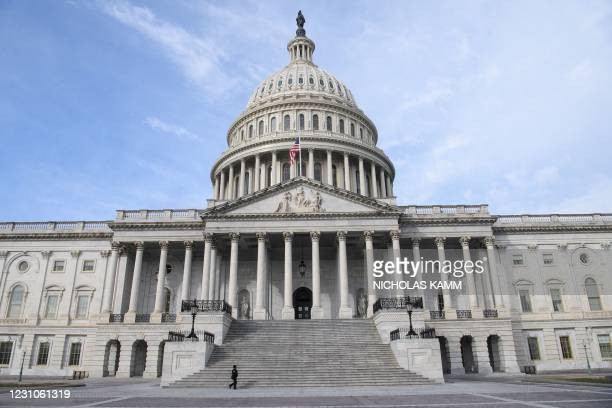 Member of the Capitol police walks past the US Capitol in Washington, DC, on February 9, 2021 before the start of former US president Donald Trump's...