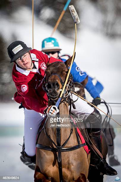 A member of the 'Cartier' team battles for the ball during the final of the Snow Polo World Cup 2015 on February 01 2015 in St Moritz Switzerland