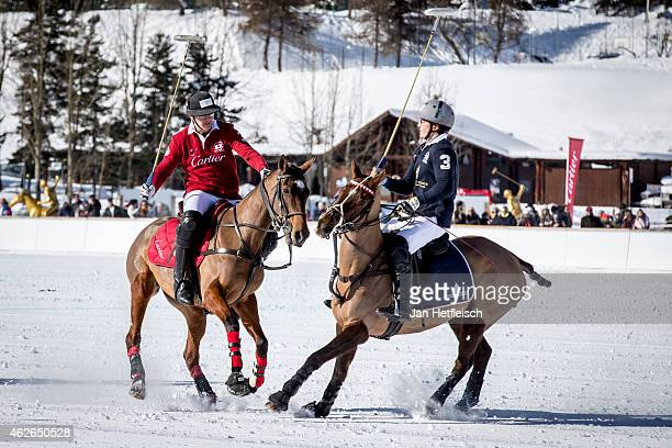 Member of the 'Cartier' team battles for the ball with team 'Badrutts Palace Hotel' during the Snow Polo World Cup 2015 on January 31 2015 in St...