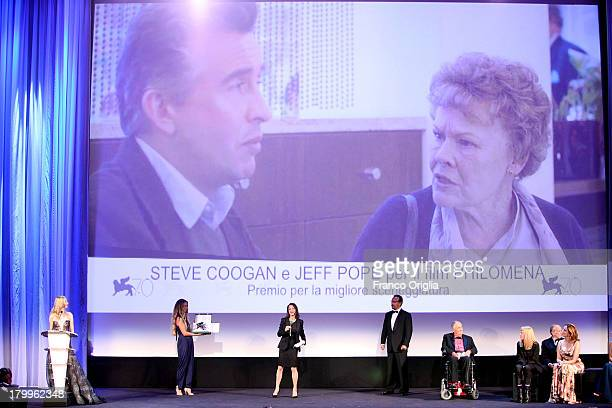 A member of the cast receives the price for Best Screenplay in place of Steve Coogan and Jeff Pope for the film 'Philomena' during the Closing...