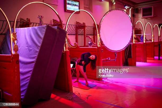 A member of the cast warms up backstage on the opening weekend of Cirque d'Hiver's new show 'Dingue' on October 17 2020 in Paris France Built in 1852...