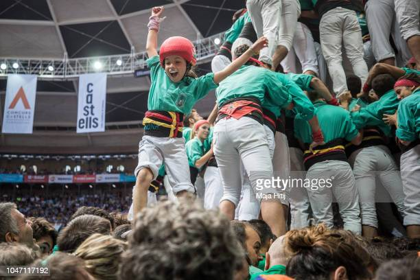Member of the Castellers de Vilafranca celebrates as they built a human tower during the 27th Tarragona Competition on October 07 2018 in Tarragona...