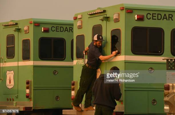 A member of the Cedar City Hot shot crew cleans the windows of his rig before his crew heads back out on the fire line of the 416 Fire on June 14...