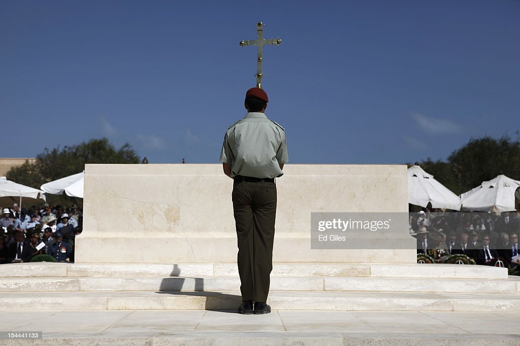 A member of the ceremonial Catafalque Party stands on the cenotaph at the El Alamein Commonwealth War Graves cemetery during commemorations for the 70th anniversary of the Battle of El Alamein on Saturday, October 20, 2012, in El Alamein, Egypt. Veterans and dignitaries from around the Commonwealth gathered at the El Alamein Commonwealth War Cemetery to commemorate the 70th anniversary of the second battle of El Alamein (October 23 - November 4, 1942). The second battle of El Alamein opened on the night of October 23, 1942, as Allied forces, including British, Australia, New Zealand and other Commonwealth soldiers, attacked the lines of German and Italian forces, starting a desert battle that would last twelve days.