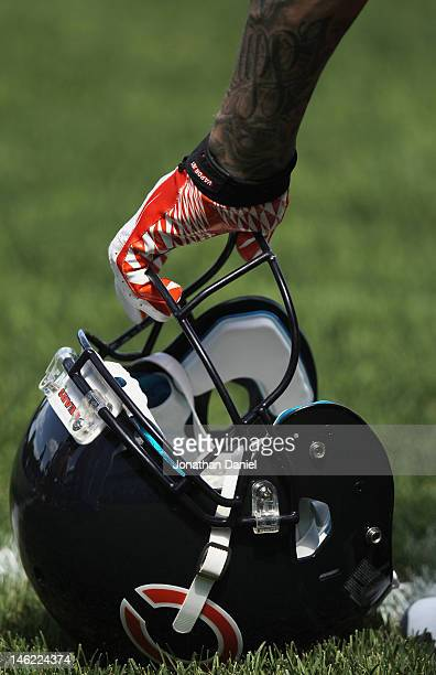 Member of the Chicago Bears leans on a helmut during a minicamp practice at Halas Hall on June 12, 2012 in Lake Forest, Illinois.
