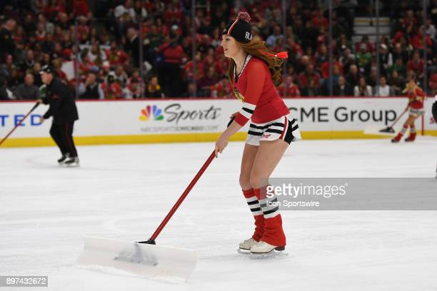A member of the Chicago Blackhawks ice crew skates during a game between the Chicago Blackhawks and the Minnesota Wild on December 17 at the United...