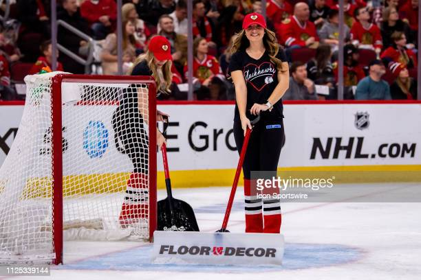 A member of the Chicago Blackhawks Ice Crew smiles for a photo during a game between the New Jersey Devils and the Chicago Blackhawks on February 14...