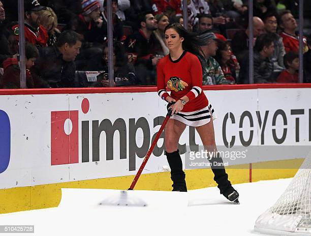A member of the Chicago Blackhawks 'Ice Crew' works during a break between the Blackhawks and Dallas Stars at the United Center on February 11 2016...