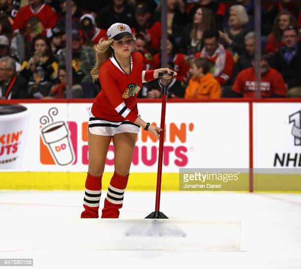 A member of the Chicago Blackhawks ice crew works during a break between the Blackhawks and the Pittsburgh Penguins at the United Center on March 1...