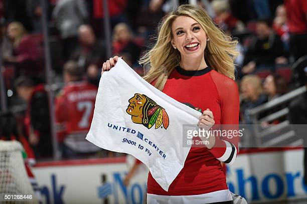 A member of the Chicago Blackhawks icecrew holds a rally towel during the NHL game between the Chicago Blackhawks and the Vancouver Canucks at the...