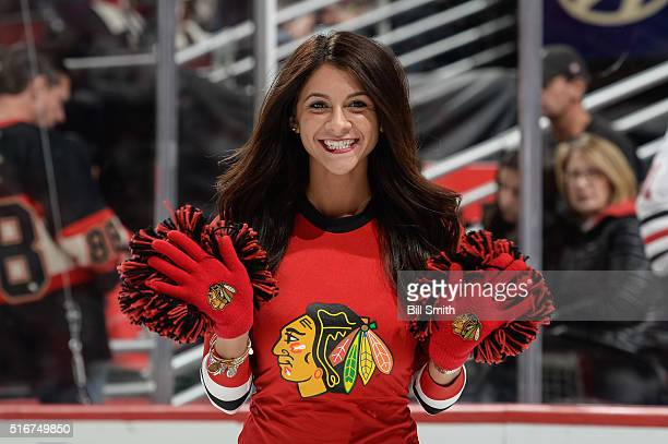 A member of the Chicago Blackhawks icecrew waves to the camera during the NHL game at the United Center on March 20 2016 in Chicago Illinois