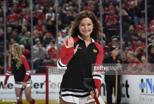 A member of the Chicago Blackhawks icecrew waves to the camera during the game between the Chicago Blackhawks and the Winnipeg Jets at the United...