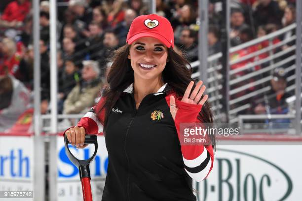 A member of the Chicago Blackhawks icecrew waves to the camera during the game between the Chicago Blackhawks and the Dallas Stars at the United...