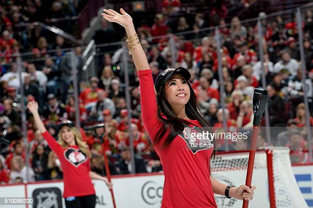 A member of the Chicago Blackhawks icecrew waves to the crowd in the first period of the NHL game between the Chicago Blackhawks and the Anaheim...
