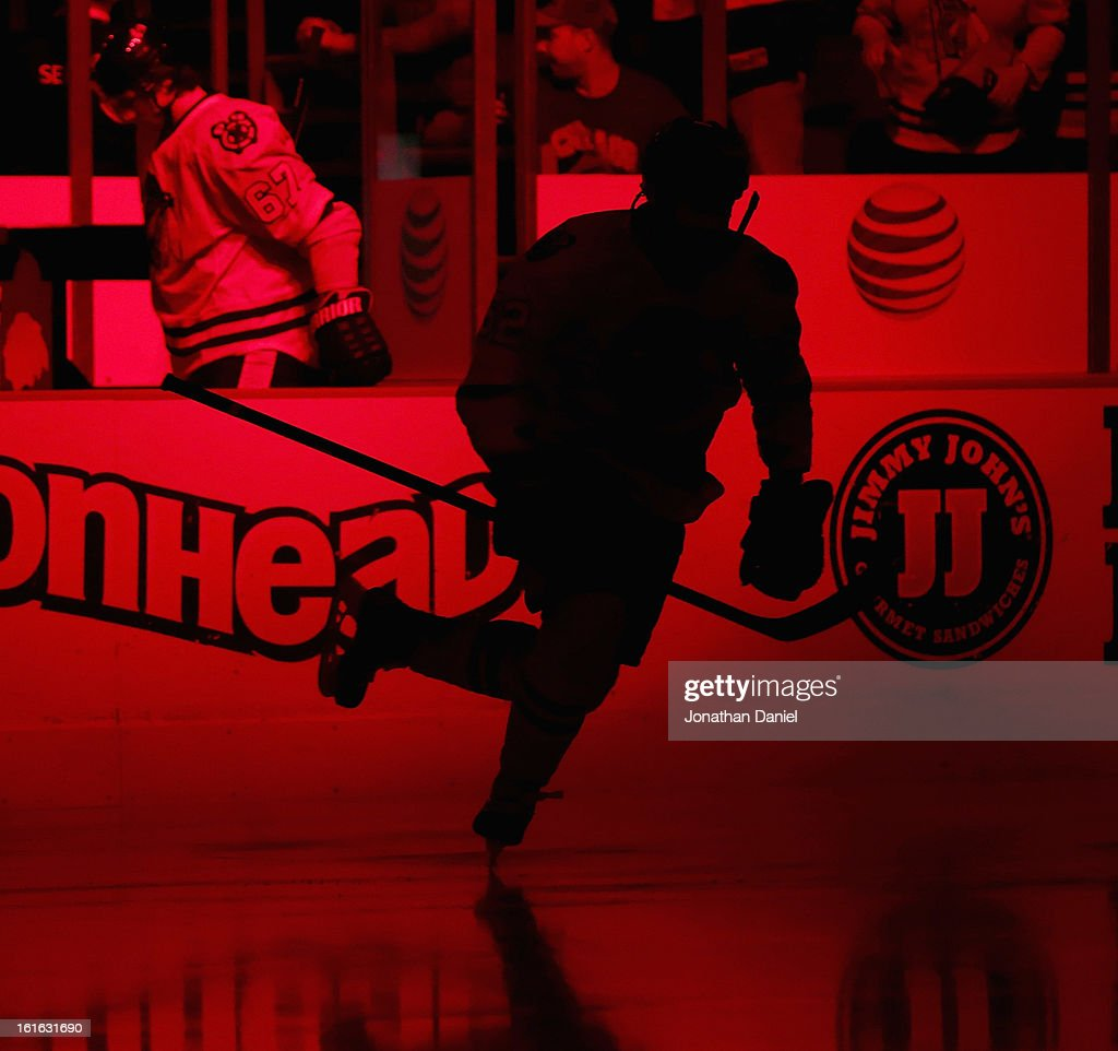 A member of the Chicago Blackhawks skates onto the ice during player introductions before a game against the Anaheim Ducks at the United Center on February 12, 2013 in Chicago, Illinois. The Ducks defeated the Blackhawks 3-2 in a shootout.