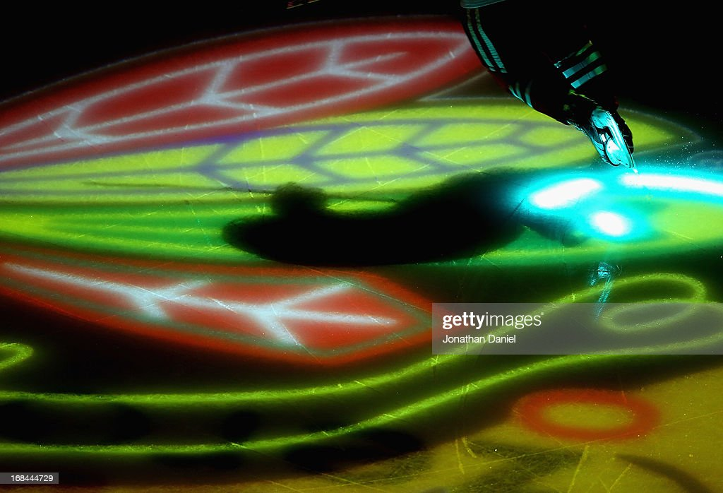 A member of the Chicago Blackhawks skates onto the ice during player introductions before taking on the Minnesota Wild in Game Five of the Western Conference Quarterfinals during the 2013 NHL Stanley Cup Playoffs at the United Center on May 9, 2013 in Chicago, Illinois.