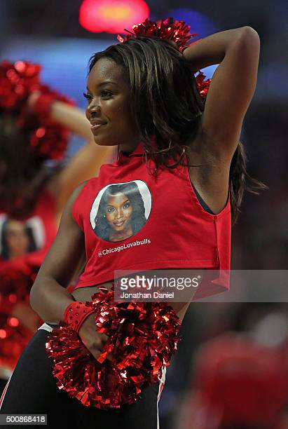 A member of the Chicago Bulls dance team performs during a break between the Bulls and the Los Angeles Clippers at the United Center on December 10...