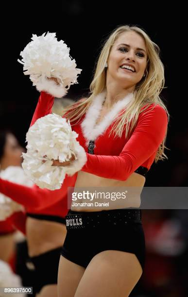 A member of the Chicago Bulls dance team performs during a break between the Bulls and the Orlando Magic at the United Center on December 20 2017 in...